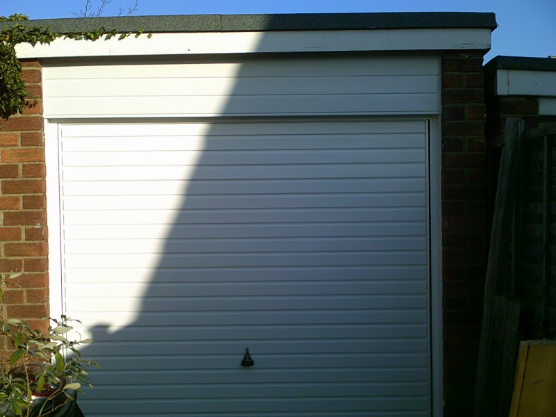 White Horizontal Rib Style Up and Over Garage Door (After)