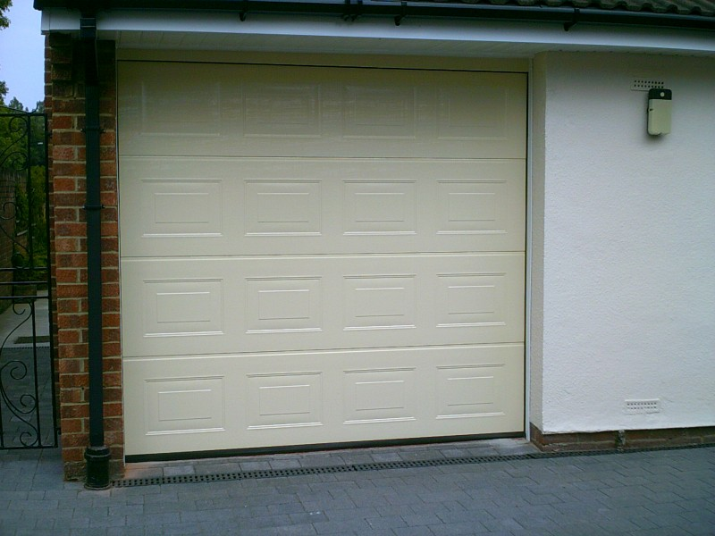 Cream Insulated Garador Sectional Garage Door (After)