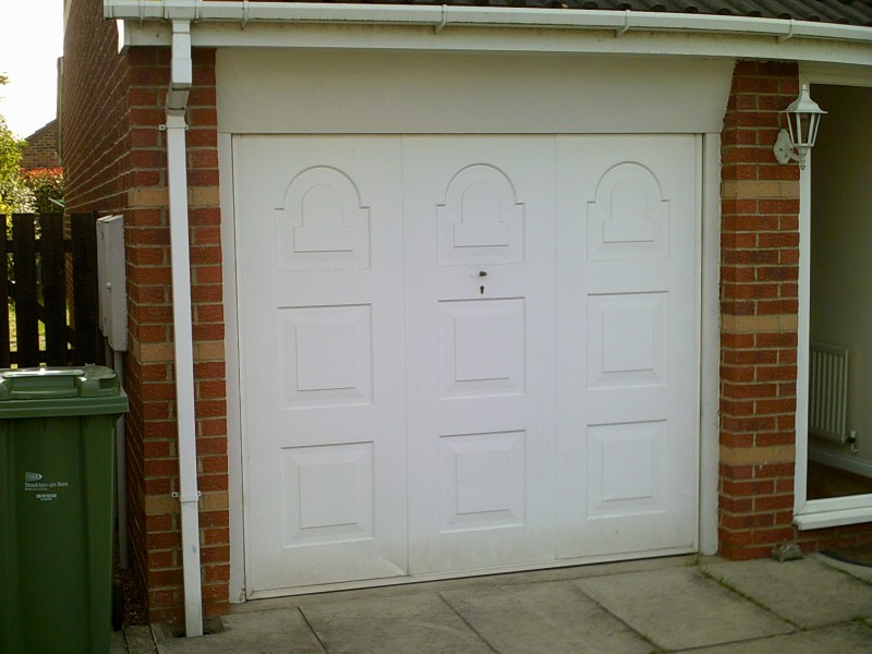 Georgian Style Sectional Garage Door (Before)