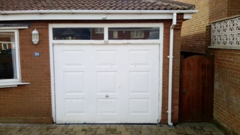 White Sectional Garage Door (Before)
