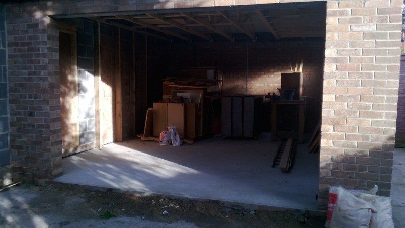 Black Micro Rib Style Sectional Garage Door (Before)