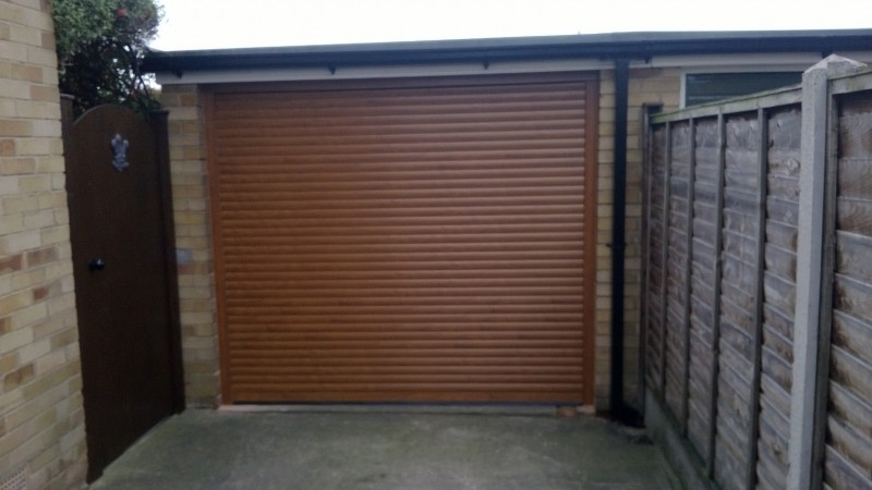 Golden Oak Laminated Insulated Roller Door (After)