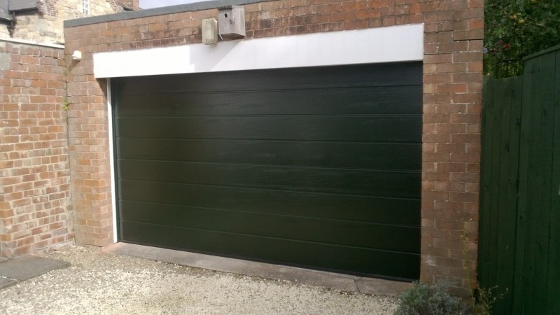 Black Sectional Garage door (After)