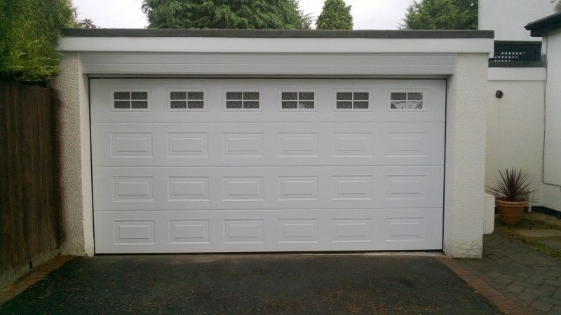 White Sectional Garage Doors with windows (After)
