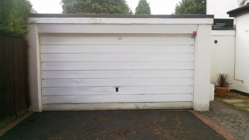 White Sectional Garage Doors with windows (Before)