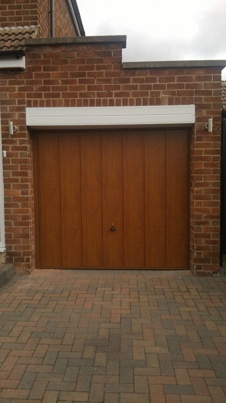 Golden Oak Laminated up and over garage door (After)