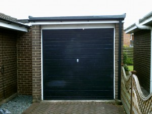 Green Carlton Garage Door (Before)