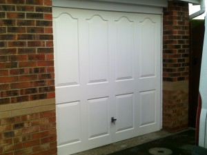 White Linear Sectional Garage Door (Before)
