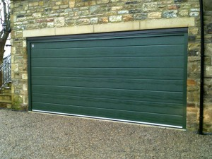 Green Sectional Garage Door (After)
