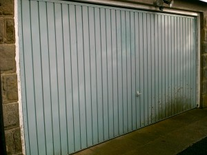 Blue Insulated Roller Garage Door (Before)