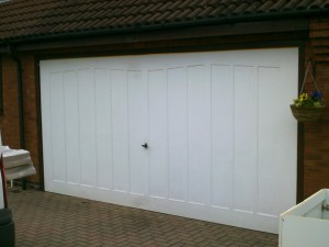 White Sectional Garage Doors (Before)