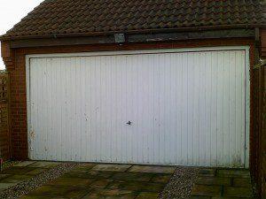 White Sectional Garage Door (Before)