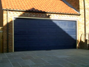 Steel Blue Georgian Sectional Garage Door (After)