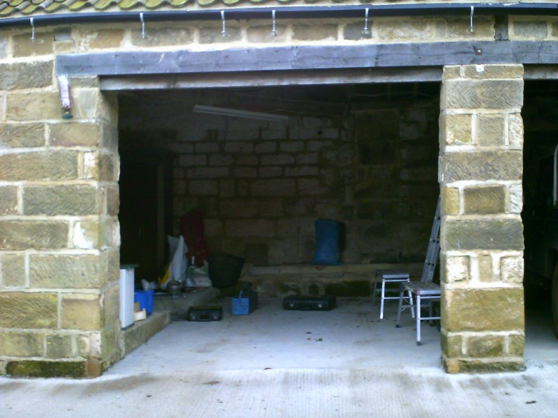 Black External Fit Insulated Roller Door (Before)