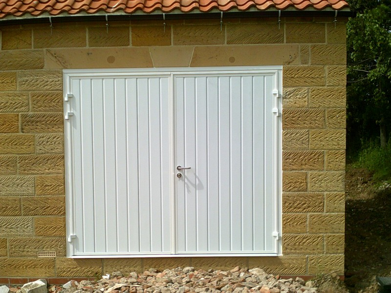 White Insulated Rib Style Side Hinged Garage Door (After)