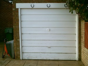 White Cathedral Up and Over Garage Door (Before)