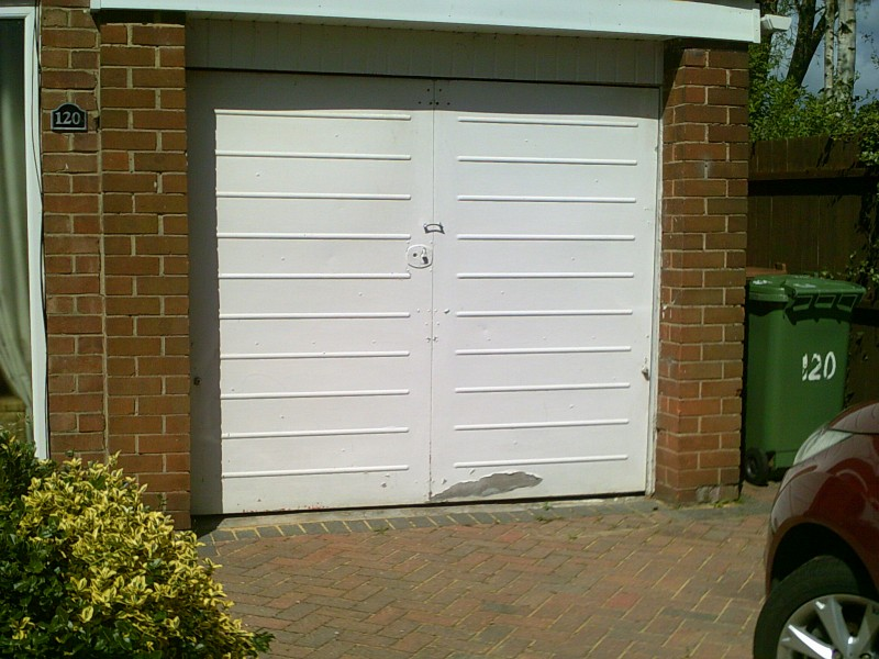 White Roller Garage Door (Before)