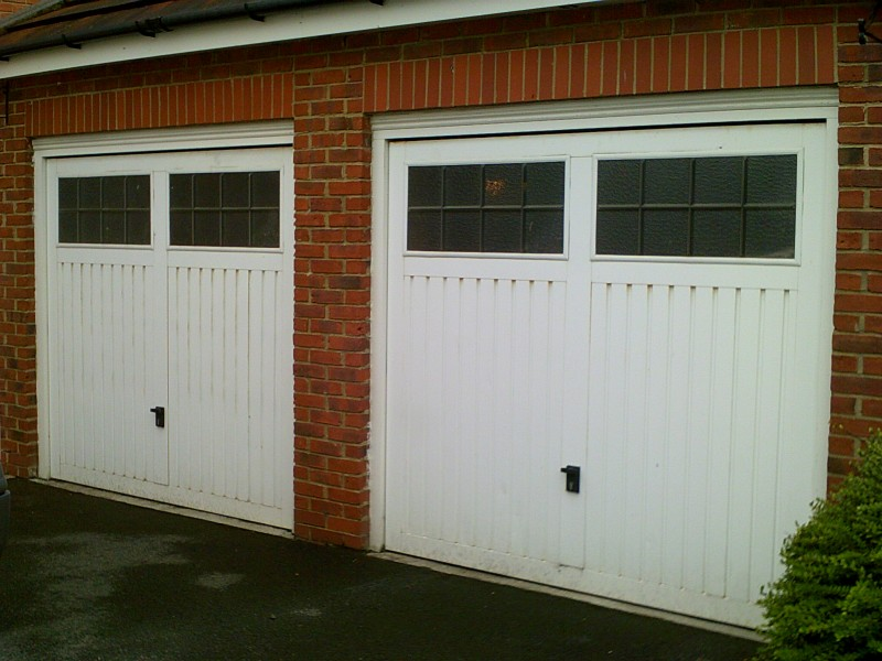 Two Insulated Sectional Garage Doors (Before)