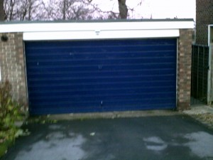 Green Insulated Roller Garage Door (Before)