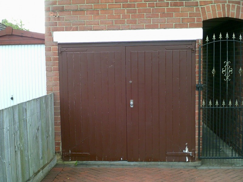 Side Hinged Cathedral Style Garage Doors (Before)
