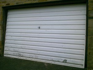 Steel Blue Garador Rectracable Garage Door (Before)