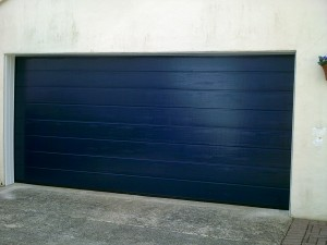Linear Style Blue Sectional Garage Door (After)