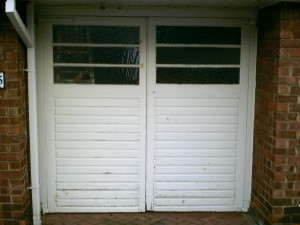 White Side-Hinged Beaumont Garage Door (Before)