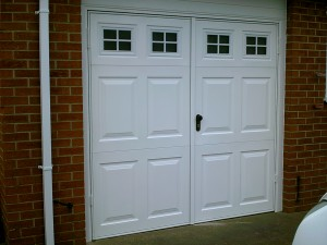 White Georgian Side-Hinged Garage Doors (After)