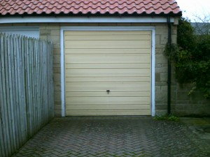 Ivory Sectional Garage Door (Before)