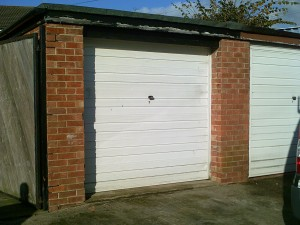 White Carlton Up and Over Garage Door (Before)