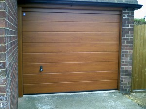 Golden Oak Sectional Garage Door  (After)