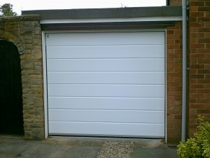 White Woodgrain Sectional Garage Door  (After)