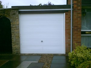 White Woodgrain Sectional Garage Door  (Before)