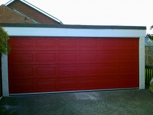 Red Woodgrain Sectional Garage Door (After)