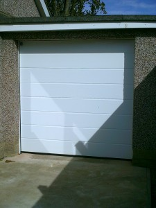 White Garador Sectional Garage Door (After)