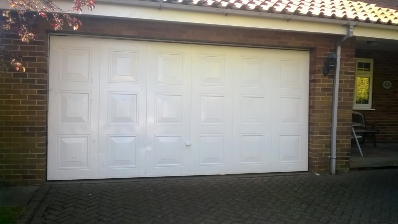Double size Georgian style sectional door with windows  (Before)