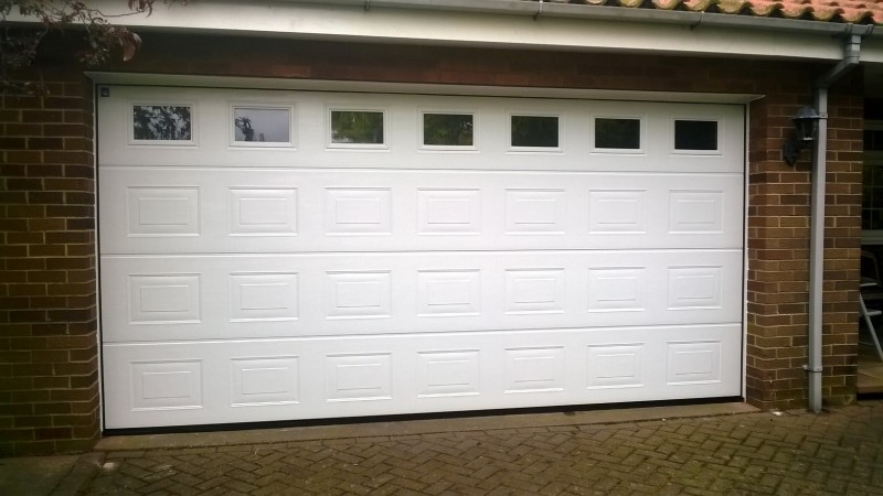 Double size Georgian style sectional door with windows  (After)