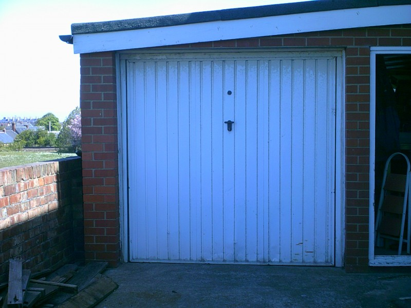 White Cathedral Style Up and Over Garage Door (Before)