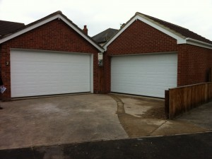White Georgian Sectional Garage Doors (After)